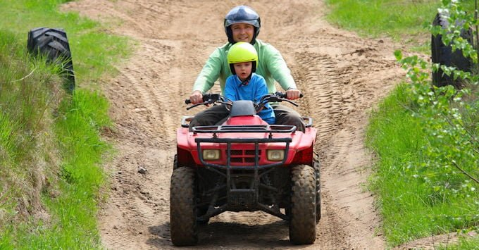 Father and son on an ATV